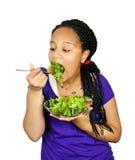 Girl having salad royalty free stock images