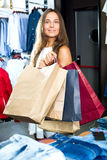 Girl having shopping paper bags in hands Stock Image
