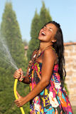 Girl having a shower bath water Royalty Free Stock Photography