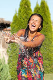 Girl having a shower bath water Stock Photography