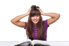 Girl having stress from reading Stock Images