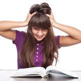 Girl having stress from reading Royalty Free Stock Image