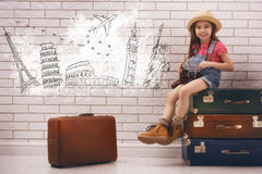 Girl having suitcases Stock Photos