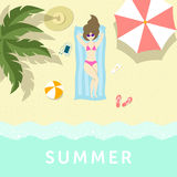 Girl having sunbathe on the sea shore under palm tree and umbrel Royalty Free Stock Images