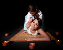 Girl having thai massage with candle. Beautiful white girl having Thai massage with candle. Beauty spa Royalty Free Stock Photo