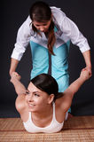 Girl having Thai massage. Health care. Stock Photo