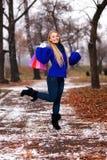 Girl having a walk outdoor in wintertime Stock Image