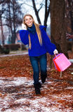 Girl having a walk outdoor in wintertime Royalty Free Stock Photos