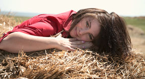 Girl on hay Stock Photography