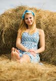 Girl on  hay Royalty Free Stock Photos
