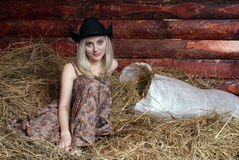 Girl and hay Stock Photos
