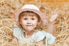 Girl in the hay Royalty Free Stock Photography