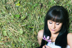 The girl on hay with flowers Royalty Free Stock Photos