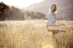 Girl in Hayfield Stock Image