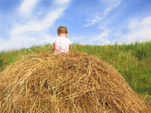 Girl on hayrack. Young girl playing on a hayrack Royalty Free Stock Images