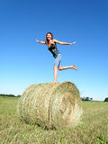 Girl on a haystack Royalty Free Stock Photography