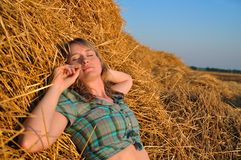 Girl on a haystack Stock Image