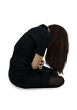 Girl with head bowed down Stock Photo
