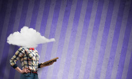 Girl with head in cloud Stock Image