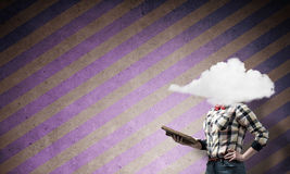 Girl with head in cloud Stock Images