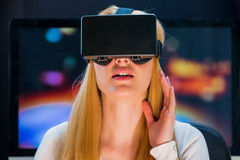 Girl in head-mounted display. Girl with pleasure uses head-mounted display Royalty Free Stock Photos