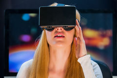 Girl in head-mounted display. Girl with pleasure uses head-mounted display Stock Photography