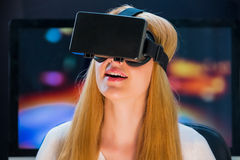 Girl in head-mounted display. Girl with pleasure uses head-mounted display Royalty Free Stock Photography