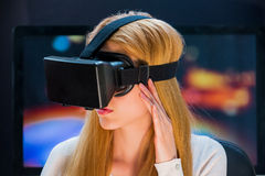 Girl in head-mounted display. Girl with pleasure uses head-mounted display Stock Photo
