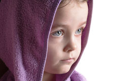 Girl head portrait wearing bathrobe hood staring Stock Image