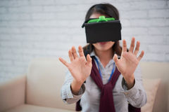 Interacting with VR. Girl in head set interacting with virtual reality Stock Photo