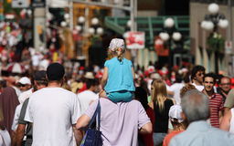 Girl on Head and Shoulders in Crowd Royalty Free Stock Photos