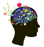 Girl head silhouette with flowers Stock Photos