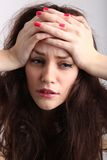 Girl with headache Stock Photos