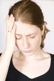 Girl with headache. Young redhead girl with headache Royalty Free Stock Photography