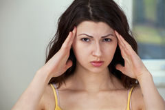 Girl with headache stock photography