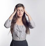 Girl headache. Beautiful young woman tired from work Royalty Free Stock Images