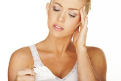 Girl with headache Stock Images