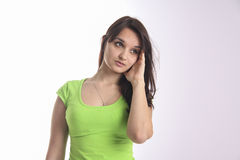 Girl with headache in green shirt Royalty Free Stock Photography