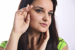 Girl with headache in green shirt Stock Images