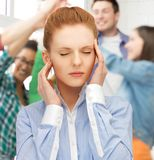 Girl with headache at school Stock Photography