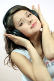 Girl with headphone Stock Photos
