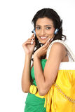 Girl with headphone and hand bag Royalty Free Stock Photo