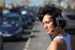 Girl in headphone set on highway middle Stock Image