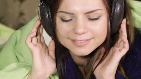 Girl in headphone stock video
