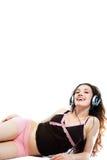 Girl in headphones 1. Girl in headphones on a white background stock image