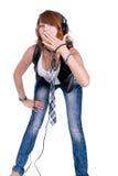 Girl in headphones Royalty Free Stock Image