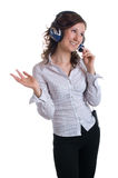 Girl in headphones. Young smiling lady in headphones. Isolation on a white background Royalty Free Stock Image