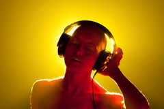 Girl in headphones. Royalty Free Stock Images