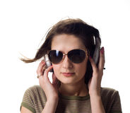 Girl in headphones. A girl in headphones smile. isolated Royalty Free Stock Photography