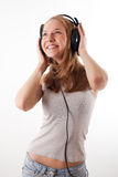 Girl with headphones. Girl in headphones listens to music Royalty Free Stock Photo